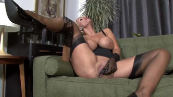Busty blonde in stockings and gloves masturbates
