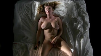 Girl masturbates with a cucumber and brings herself to orgasm