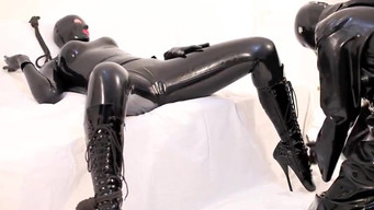 Bondage and strangulation of a latex girl