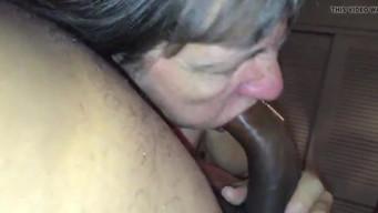 Old granny superbly sucks a black man's long black cock