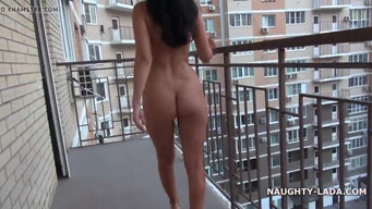Exhibitionist walks naked in the porch and on the balcony of the house
