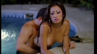 Night bathing and sex in the pool with a luxurious Asian