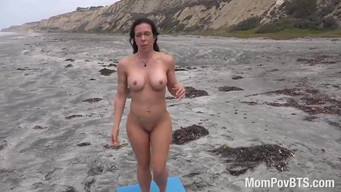Naked athlete is training on the beach