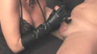 Mature slut in leather gloves licks cum from a hefty dick