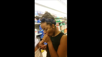 Ebony sucks cock from a white man in a supermarket