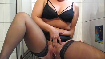 The wife in stockings took off for her lover as she pisses in the toilet on the toilet