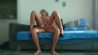 Tanned slender wife jumps on a dick of her lover in a hotel