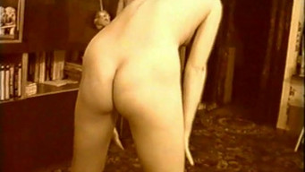 Homemade retro video as a wife shows amateur striptease