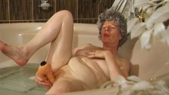 Gray-haired 60-year-old grandmother masturbates in the bathroom alone
