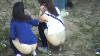 Girls piss on the river bank after graduation, and the weirdo takes them off