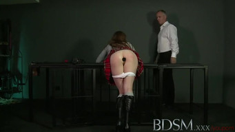 The teacher spanked a schoolgirl with butt plug in the ass in the BDSM room