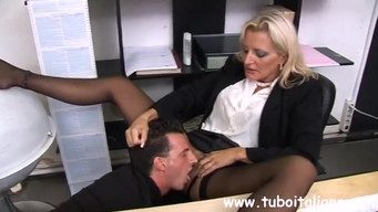 The boss forced the accountant to lick her legs in stockings and pussy