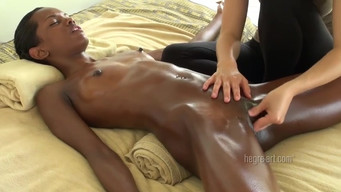 White masseuse gently masturbates a black woman's pussy