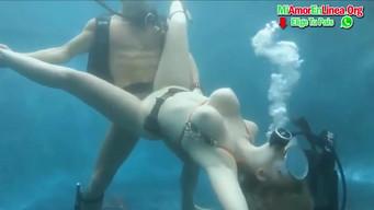 Tourist in scuba fucks with a swimming teacher under water